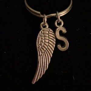 Key chain with angel wing and initial S.